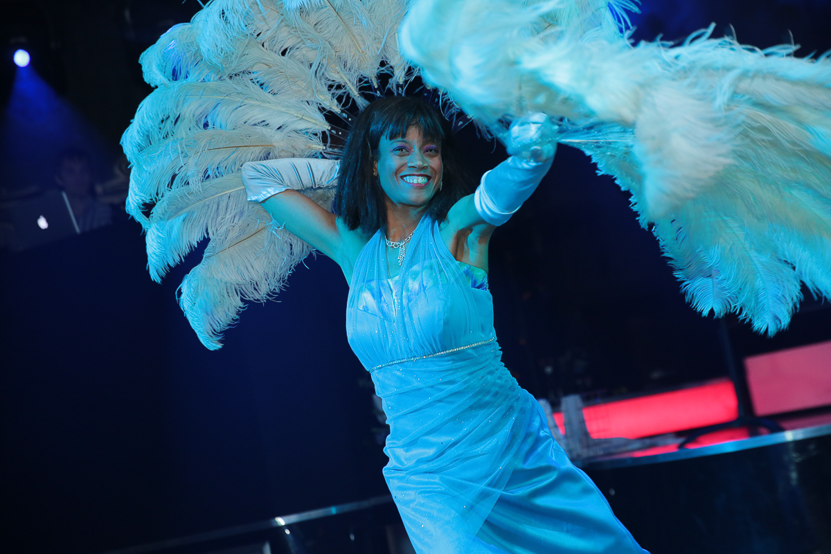 The Luvely Rae performing a burlesque fan dance.